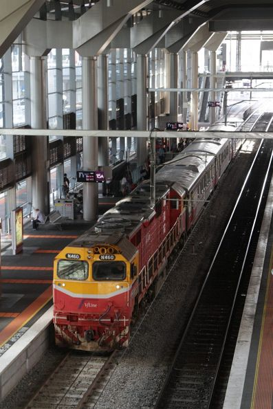 N460 and a 3-car H set with a down Traralgon service at Southern Cross platforms 15