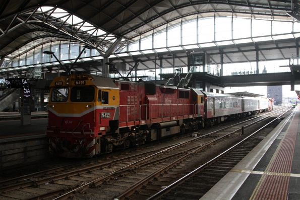 N459 sits on the tail end of a train in platform 5, having brought the carriage set over from the yards