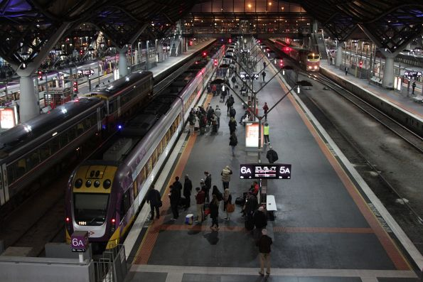 Passengers wait on the platform before boarding their V/Line train at Southern Cross Station