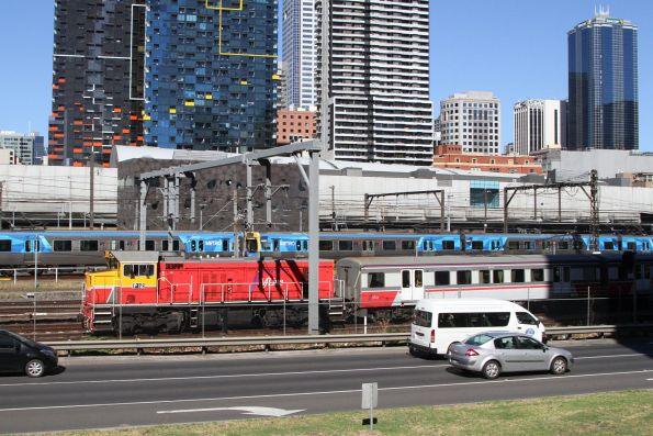 P12 leads a push-pull train out of Southern Cross platform 16