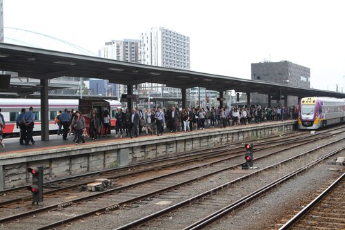 Stream of passengers exit their train at the north end of platform 3