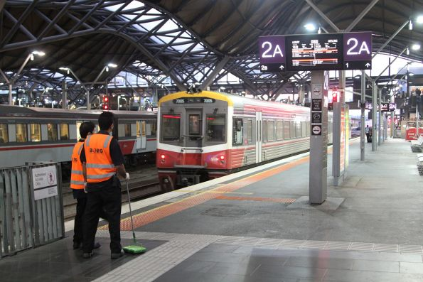 V/Line carriage cleaners employed by Borg wait at Southern Cross Station for an arriving train