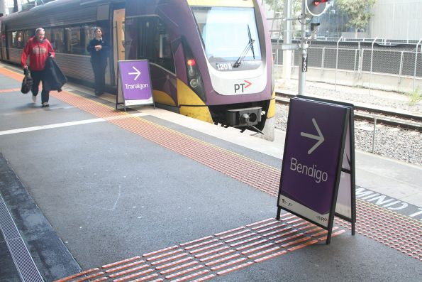 'Traralgon' and 'Bendigo' signs  at Southern Cross platform 16 directing passengers to the correct train