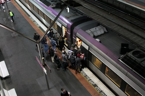 V/Line passengers board a VLocity train at Southern Cross platform 2