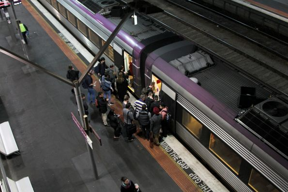 V/Line passenger board a VLocity train at Southern Cross platform 2