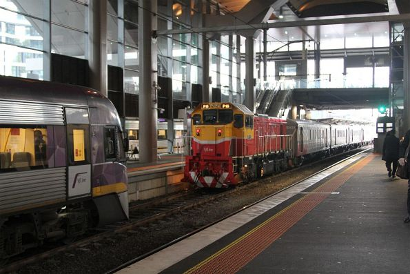 P15 trails a  push-pull train out of Southern Cross Station platform 15
