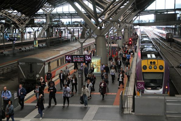 V/Line passengers depart their train at Southern Cross platform 3