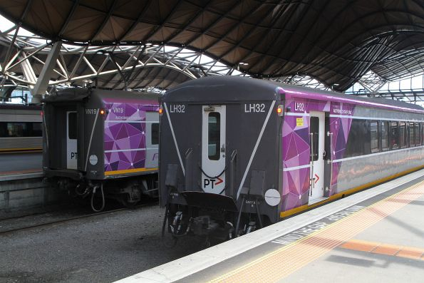 Carriage sets VN19 and LH32 stabled in the platform at Southern Cross