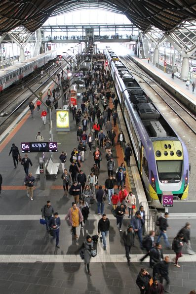 V/Line train packed to the rafters, and drops off passengers at the north end of Southern Cross platform 5