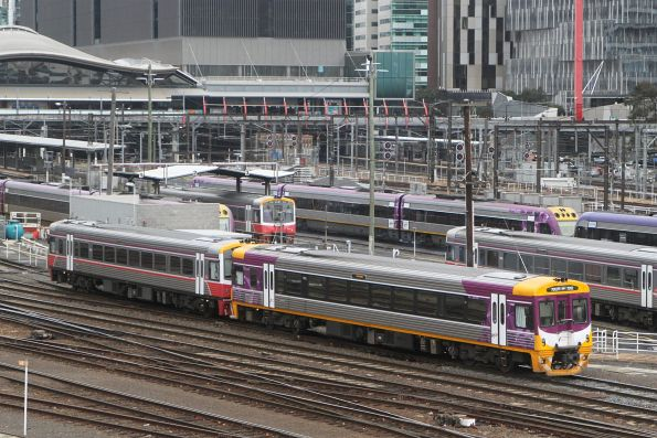 PTV liveried Sprinter 7012 and VLP Mk3 classmate 7014 depart Southern Cross