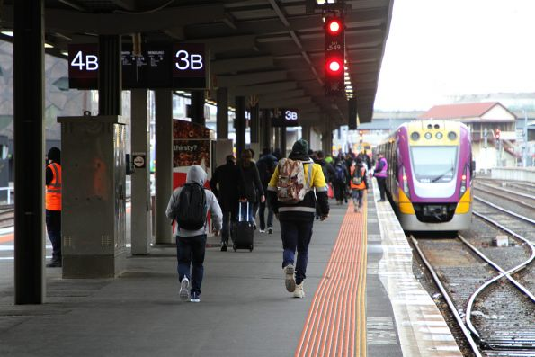 V/Line passengers make the long hike north to Southern Cross platform 3B