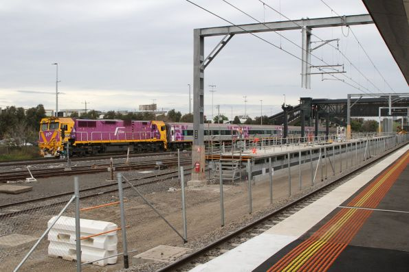N457 leads the down Albury service through West Footscray