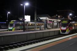 Down Geelong service pauses at Footscray platform 6, with a stranded Bacchus Marsh service on the RRL tracks
