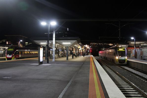 Citybound Bendigo service stops in the suburban platform at Footscray, with a stranded Bacchus Marsh service in platform 4