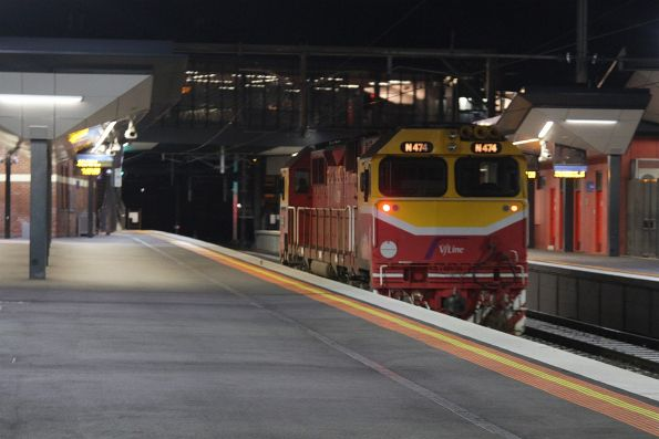 N474 passes light engine through Footscray platform 2, bound for Sunshine to shunt stranded trains back to Melbourne