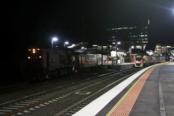 P17 leads an up empty car move through Footscray platform 5