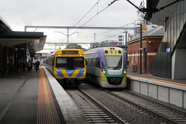 VLocity VL26 on a down Waurn Ponds train at Footscray platform 2, passes life extension EDI Comeng 355M