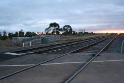New concrete sleepers stacked beside the Geelong line at Lara