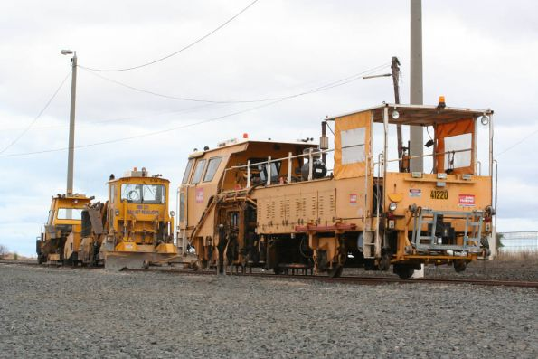 John Holland broad gauge track machines stabled at Gheringhap, Plasser 07-16B tamper coded 41220, Plasser PBR 201B regulator coded 6-54-015 or 41117, and Harsco CSC-II ballast consolidator coded 41307