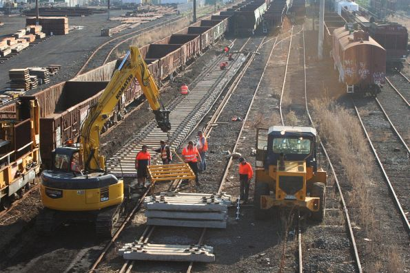 Placing new concrete sleepers into position