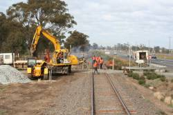 Replacing timber sleepers over a small bridge north of Shepparton
