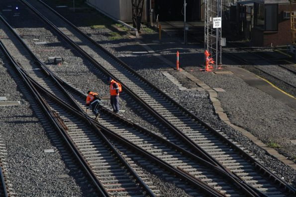 V/Line staff inspecting the dual gauge points outside Southern Cross Station
