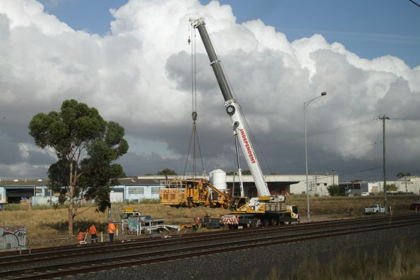 Ballast tamper being lowered onto the tracks at the Sunshine GEB sidings