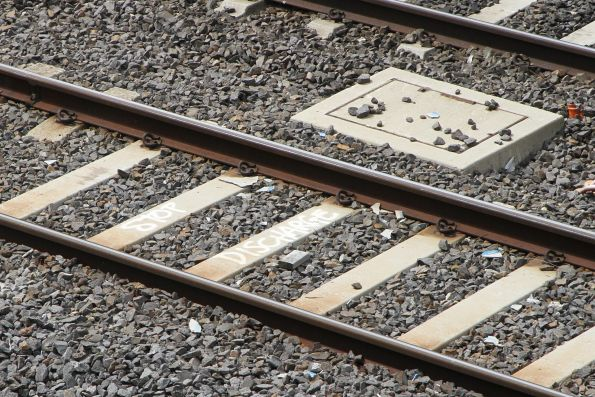 'Stop discharge' marked on the sleepers at Footscray