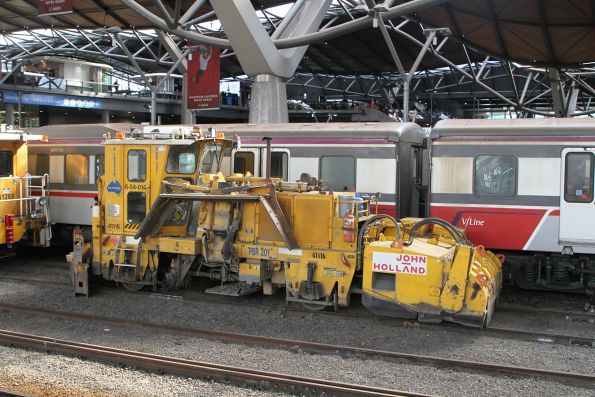 John Holland ballast regulator 41116 6-54-014 stabled at the south end of Southern Cross platform 3