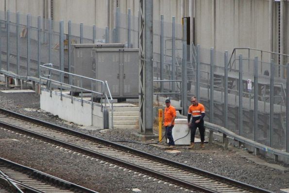 V/Line staff attend to the automatic rail lubricators on the approach to the North Melbourne flyover