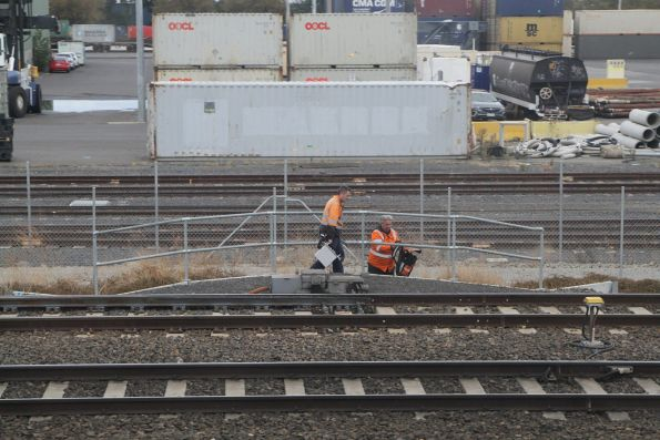 V/Line staff wrap up their repairs to a track fault on the RRL tracks at South Kensington