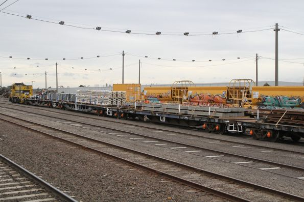 Sleepers, rail, fencing and barriers loaded onto a Southern Cross Station works train at Tottenham Yard