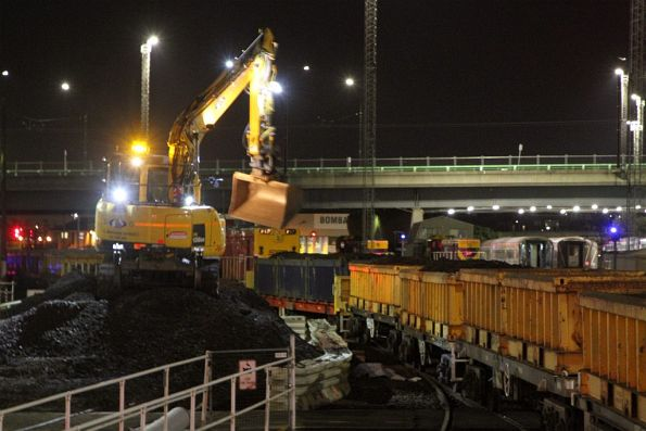 Excavator loads a spoil train at Southern Cross Station