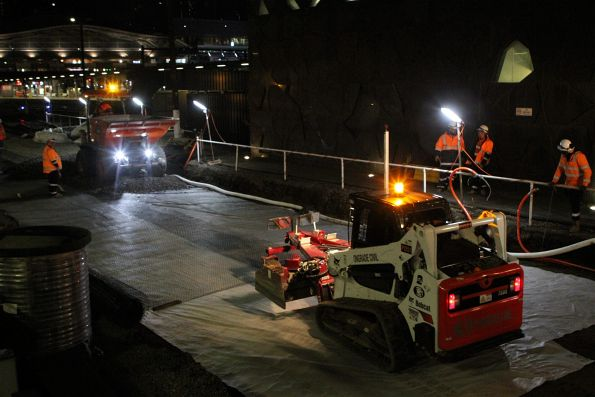 Laying down geotextile fabric and ballast on the track bed at the north end of Southern Cross platform 4