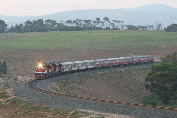 N465 leads N463 and P15 with nine empty H carriages out of Bacchus Marsh through the Parwan Curves