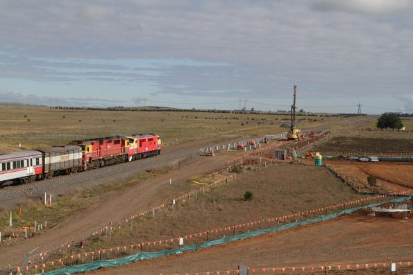 A66 leads N469 passes the future Caroline Springs station with a down empty cars move