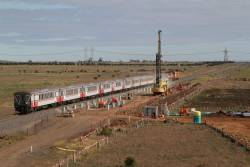 Twelve carriage empty cars move passes Caroline Springs, bound for Bacchus Marsh