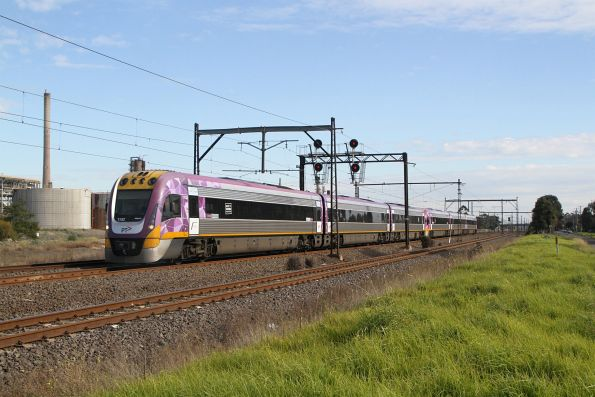 VLocity VL52 leads a damaged VL69 back through Altona Junction on the up