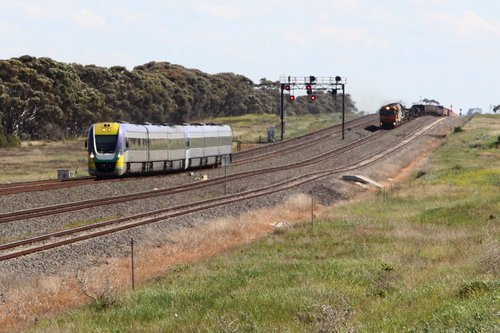 Pair of VLocities Melbourne bound overtake the up steel train at Manor Loop