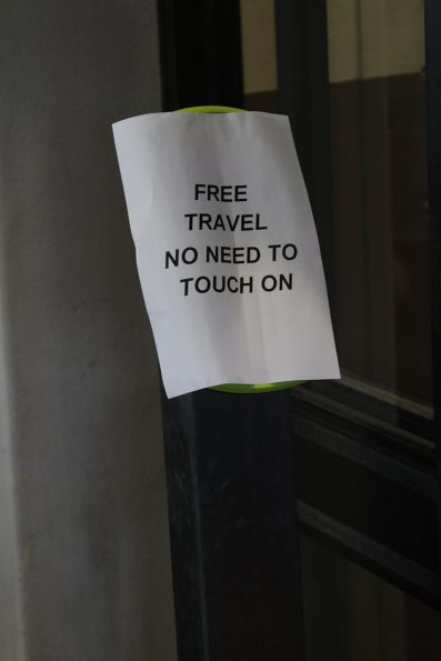 Computer printed 'Free travel - no need to touch on' message on a myki reader at Ballarat station