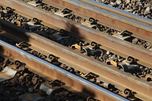 Clamps to prevent lateral movement of concrete sleepers on the North Melbourne flyover