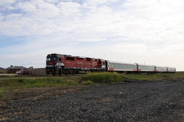 N451 leads the down Warrnambool service past new housing developments at Grovedale