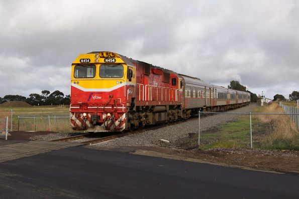 N454 leads the up Warrnambool over the new level crossing for the Anglesea Road deviation
