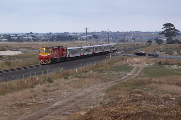 N460 leads the down Warrnambool out of Geelong at Anglesea Road