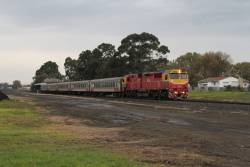 N453 leads a down Warrnambool service away from Terang station