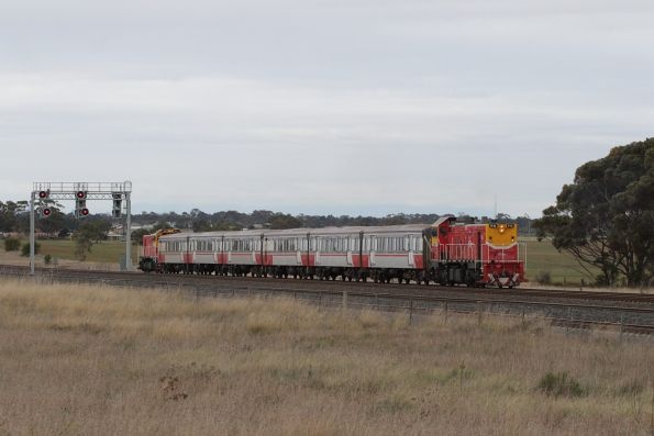 With the down Geelong service having cleared the section ahead, the rail cleaning train heads south for Little River