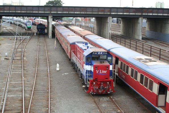 P14 stabled on a push-pull at Melbourne Yard, another set alongside, a VLocity up the far end, and a single loaded quarry hopper hiding under the bridge