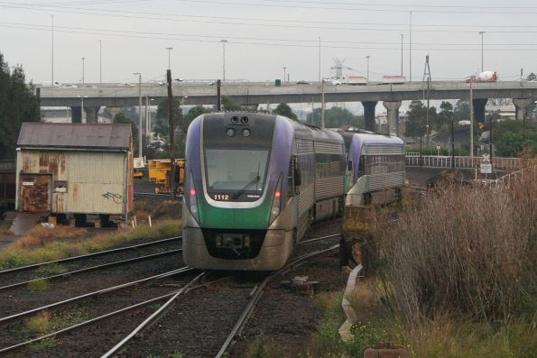 VLocity VL12 at Reversing Loop Junction trails an empty car move to South Dynon