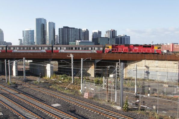 N467 and a H set crosses the North Melbourne Flyover with empty cars for South Dynon