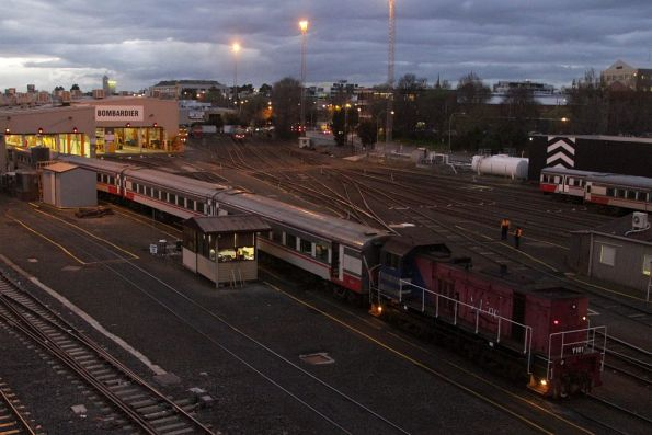Y161 drags a carriage set out of the Bombardier maintenance sheds at West Melbourne
